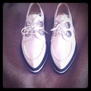 Alexander McQueen white loafers